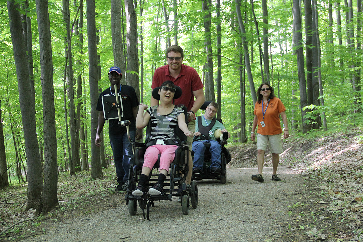 First time visitors on the ADA accessible trail. Photo Credit: John Bullington