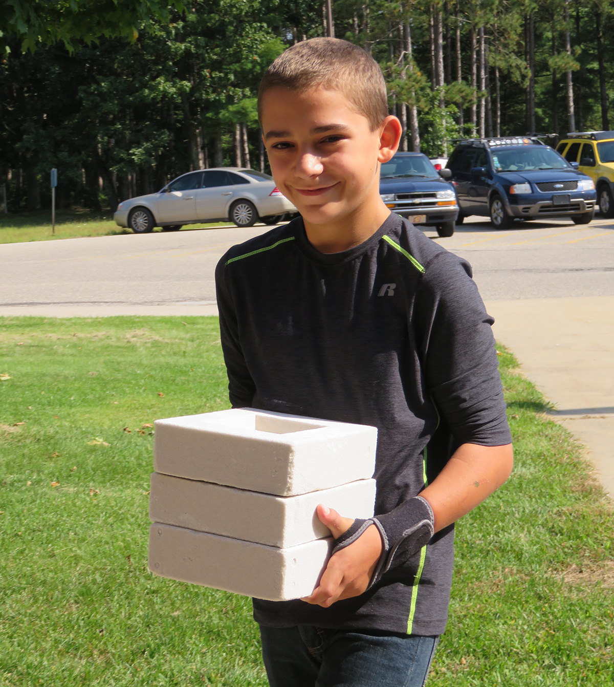 Helpful student carrying scratch blocks
