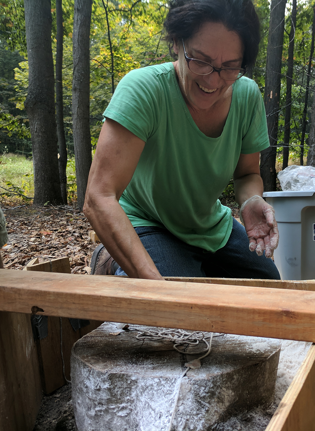 Theresa Smith creating molds in the forest