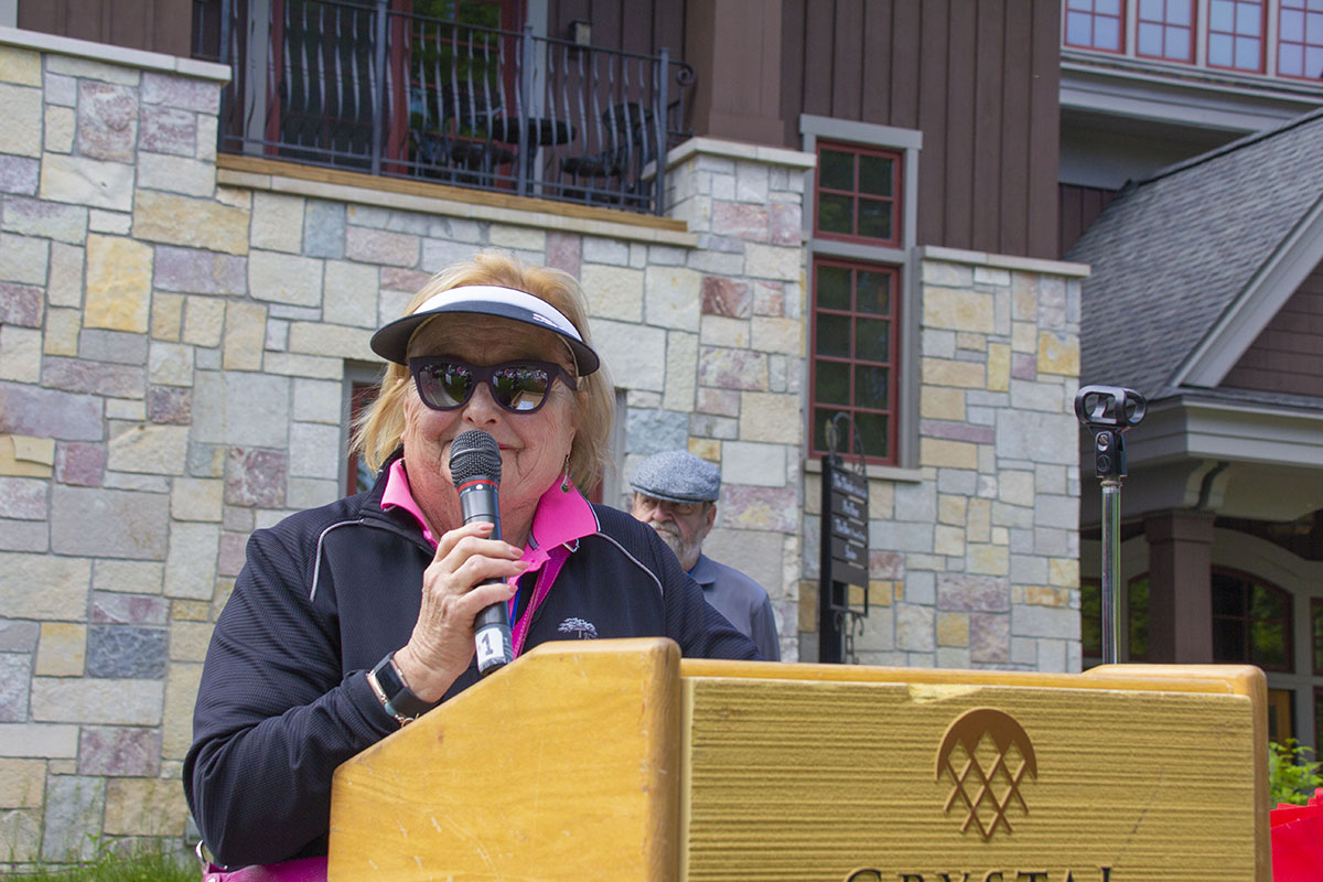Golf Classic Chair Diane Wilbur celebrates the planning committee at the close of the day